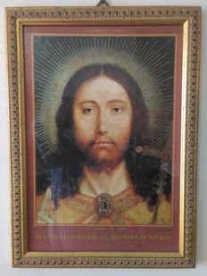 Two pictures of Jesus and Padre Pio
