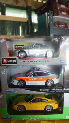"Nex Models / Burago - Scale 1/18 - Lot with 3 models: Porsche GT3, Porsche 991 Carrera S & Porsche 997 Carrera S ""Polizei"""