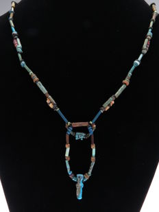 Egyptian necklace of faience beads with Eye of Horus (Wedjat) and Isis amulet - 58 cm