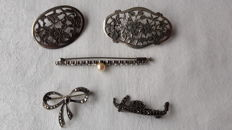 Five silver brooches