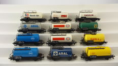 Märklin H0 - 4440/4646/4560/4647/4441/4442/4642/4644 - 12 two axle tanker wagons with different corporate logos of the DB