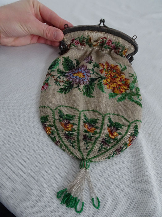 Beautiful beaded purse with silver brace