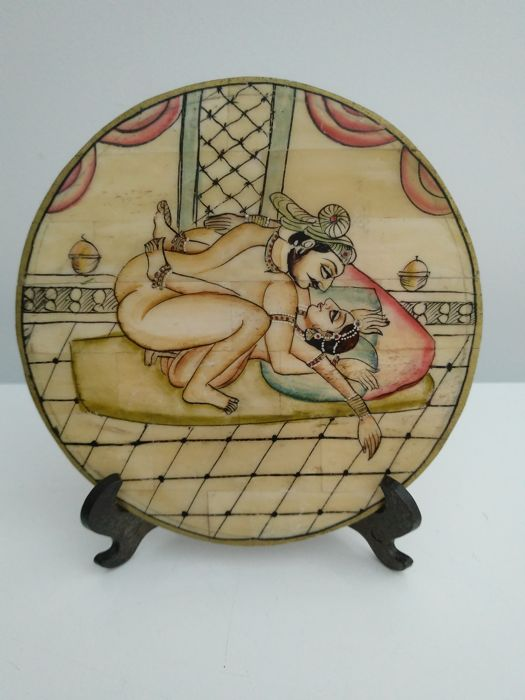 Camelbone plate depicting an erotic scene - India - late 20th century