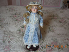 old porcelain doll (rare)