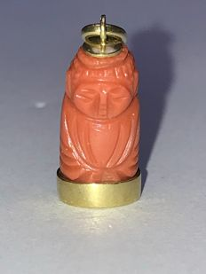 Old carved coral monk in 18k pendent