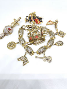 Vintage Spanish set of charm bracelet, Galleon Brooch, Bullfighter with bull, Matador brooch and tie clip.