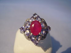 Cocktail ring with natural ruby of 1.4ct and an entourage of tanzanites of 1.60ct.