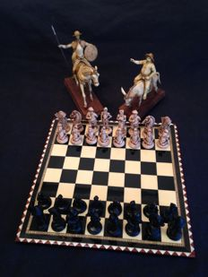 Vintage chess of Don Quixote and Sancho Panza on marquetry board and figure