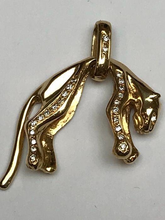 Large heavy  18k gold panther with 0,25ct diamonds pendant