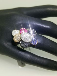 Gold ring with black, white and pink Diamonds, Rubies and Sapphires.