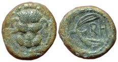 The Greek Antiquity - Bruttium, Rhegion c. 425-410 BC - Æ (Bronze, 10mm, 1,03g.) - Lion-scalp facing / P H with leaves of olive sprig - Rutter HNItaly 2522; SNG ANS 683.