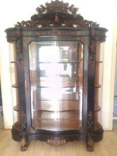 Attributed to Gebrs. Horrix 's-Gravenhage: a richly carved Willem III bois noirci and walnut display cabinet - the Netherlands - circa 1860
