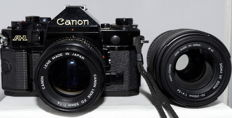 Canon A-1 body with 2 lenses