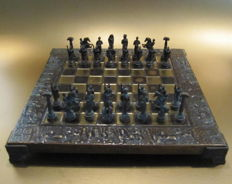Detailed chess game of bronze/copper