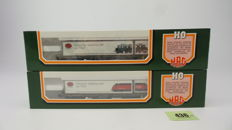 """HAG H0 - 388 - Two four axle flatcars Sgss with containers from """"HAG Sweizer Spitzenqualität"""" of the SBB"""