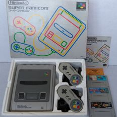 Boxed Super Nintendo console (Japanese import) with universal power supply, 2 controllers  and 3 games: Super Donkey Kong 2, Super Bomberman 2 and Dragon Ball Z Super Butouden 2