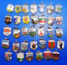 Collection of 34 coat of arms, glaze, travel, shield, silver bracelet, charm