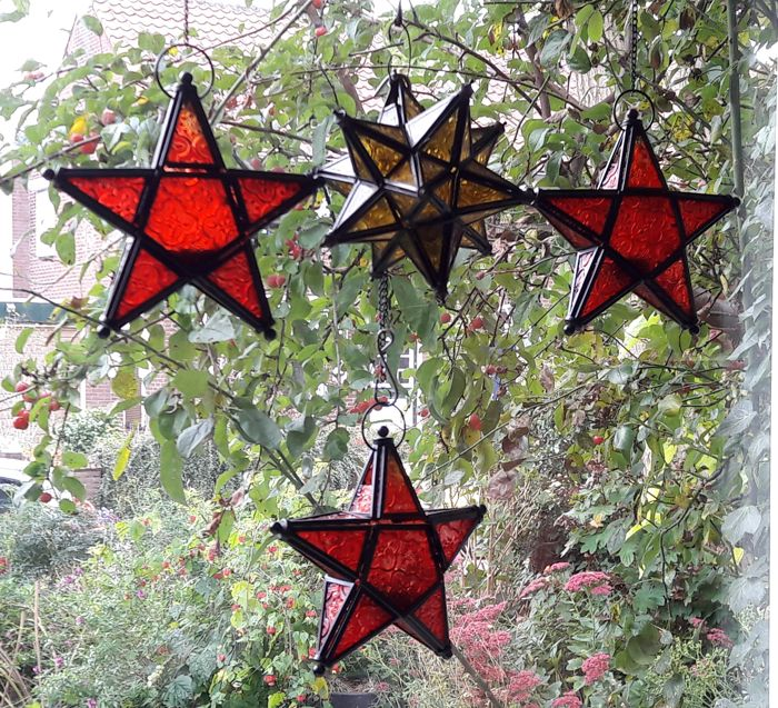 Four three dimensional glass Christmas stars with room for a tea light - Middle of 20th century