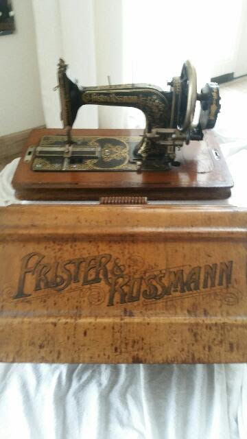 Antique sewing machine by Frister & Rossman including a wooden cover, 1st part of the 20th century