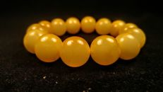 Baltic Amber Round modified beads Rare Egg yolk colour - Hand ca. 58 mm diameter