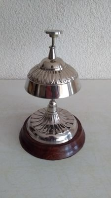 High silver plated hotel bell - counter bell on wooden base.