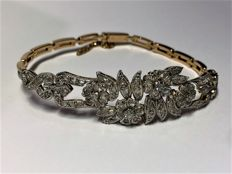 Bracelet - 18 kt yellow and white gold - Main stone brilliant and antique cut diamond weighing 0.62 cts - Length 18.5 cm, Width 1.6 cm