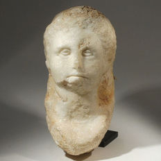 Roman head, possibly not finished - H. 17 cm.