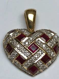 Large vintage heart with calibrated natural  Ruby's and diamonds 18k