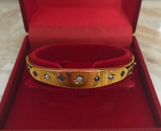Art Deco bracelet bangle with diamonds approx. 0.35 ct And sapphires approx. 0.30 ct. Made of gold 585/14 kt, around 1910. England