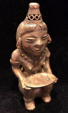 A South American Tumbaga Gold, Colombia,  Tairona figure  100 x 41 x 45 mm, 75.70 grams., A figure of a Priestess