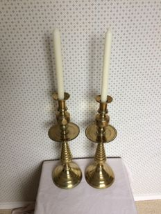 A set of brass church candlesticks, 19th century Spain