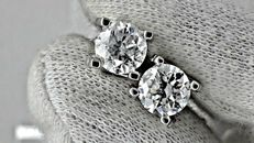 2.06 ct round diamond stud earrings 18 kt white gold