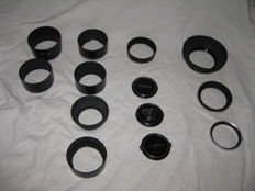 Canon 9 lens hoods, 3 x lens caps and 1 adapter ring (1976)