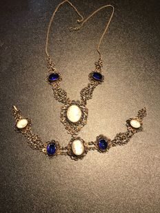 silver necklace and bracelet set with shell carved cameo and blue glass