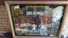 Two Coca cola advertising signs of wood and glass from the 20th century