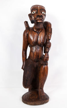 Large and heavy African wooden sculpture of a hunter and his game.
