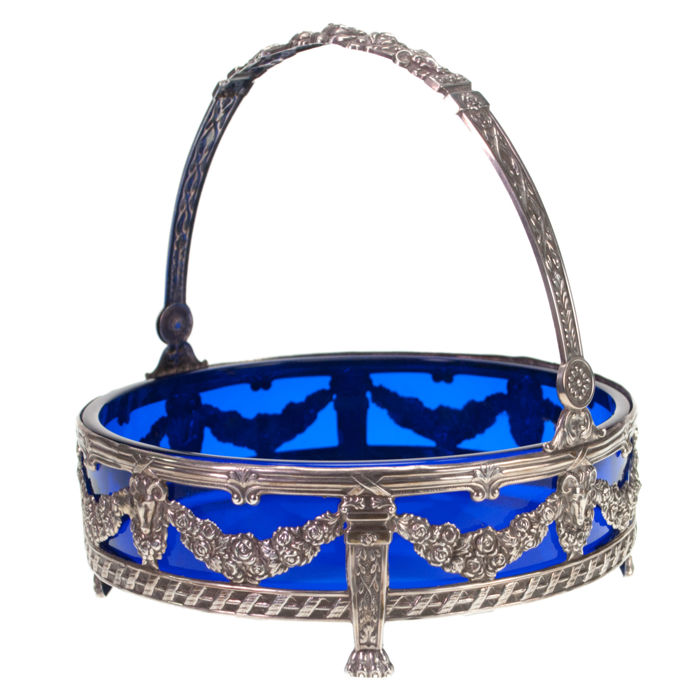 This charming basket features blue Glass in Silver