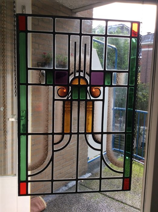 Hand-stained glass SunCatcher with mosaic pieces of Amsterdam School - approx. 1920