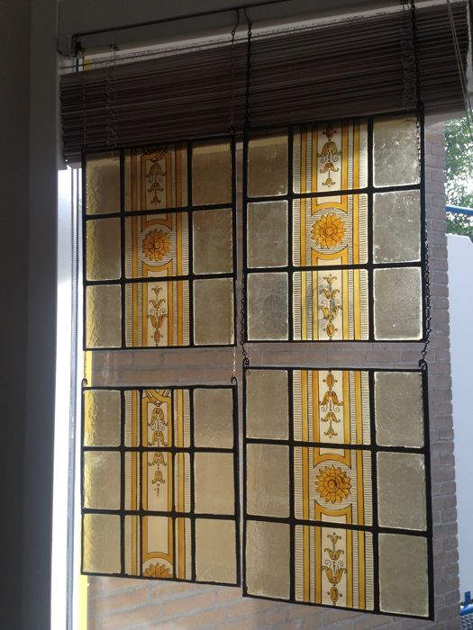 Series of four beautiful hand-stained (silver oxide with soft colours) stained glass sun-catchers - circa 1920 - depicting classical architectural motifs