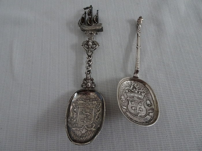 2 items: Dutch silver spoons with crest and large sailing ship on the of the spoon and 1 with the city crest of Haarlem - early 1900