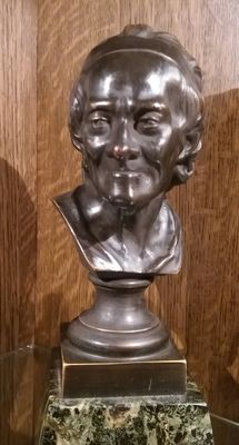 After Jean-Antoine Houdon - bronze portrait bust of the writer/philosopher Voltaire on a green marble base - France - circa 1900