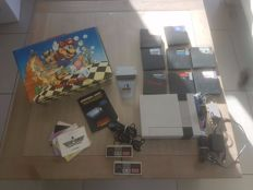 Nintendo nes with 7 games , game key and very rare official nintendo nes suit case