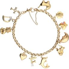 14 kt - Yellow gold anchor link bracelet with charms in the shape of a pram, symbol set with brilliant cut diamond, and a cross set with a brilliant cut diamond, among others - Length: 18 cm.