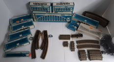 Märklin H0 - 5100/-01/-02/-06/-07/-09/-10/-11/-12/-13/-20/-41/-42/5200/-02/-21/7262/-63 - 91-piece M-rail package with bridges and electric switches