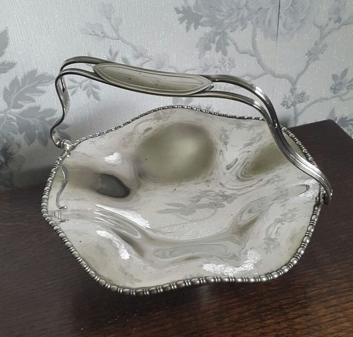 Lot 731 - Antique silver plated basket centrepiece, scalloped into waves effect, marked William Suckling.  England 1930s