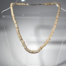 Necklace of round shell beads.