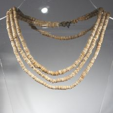 Very long necklace of beads made out of ostrich eggs