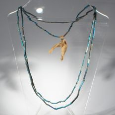Necklace of mummy beads in various shades of blue