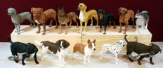Collection of 12 dog figurines