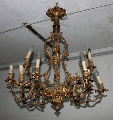 A Louis XV style 16-light gilt-bronze chandelier - France - 19th century